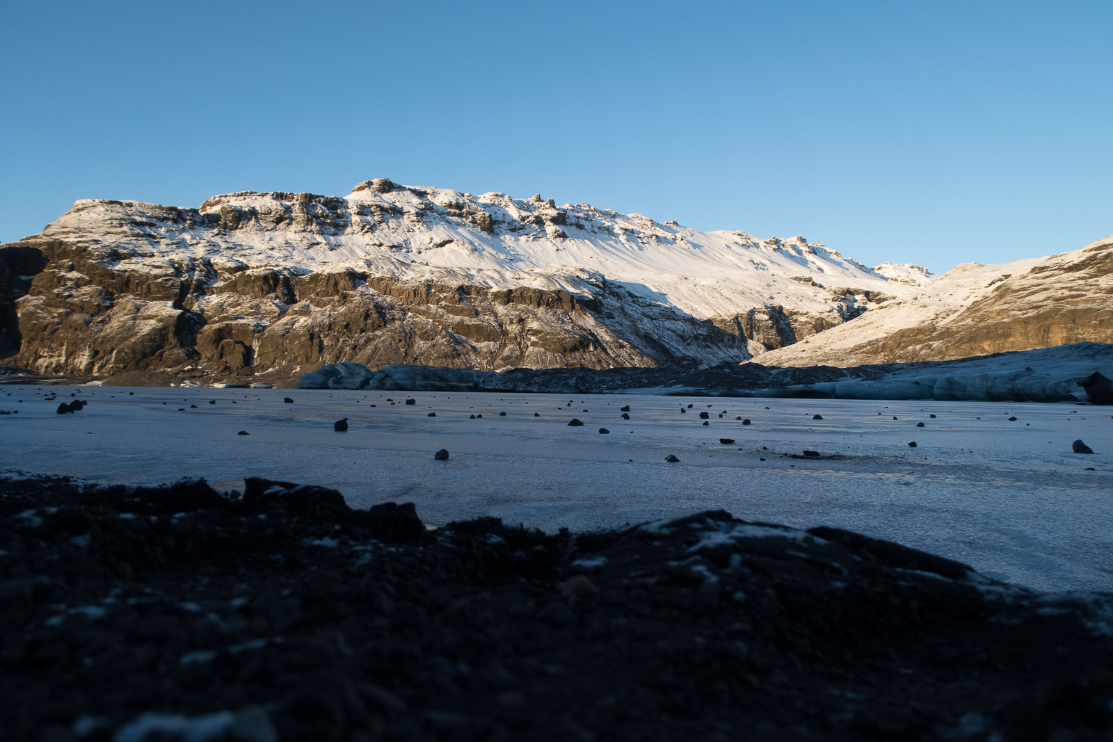 The frozen landscape and mountainous backdrop in Iceland.
