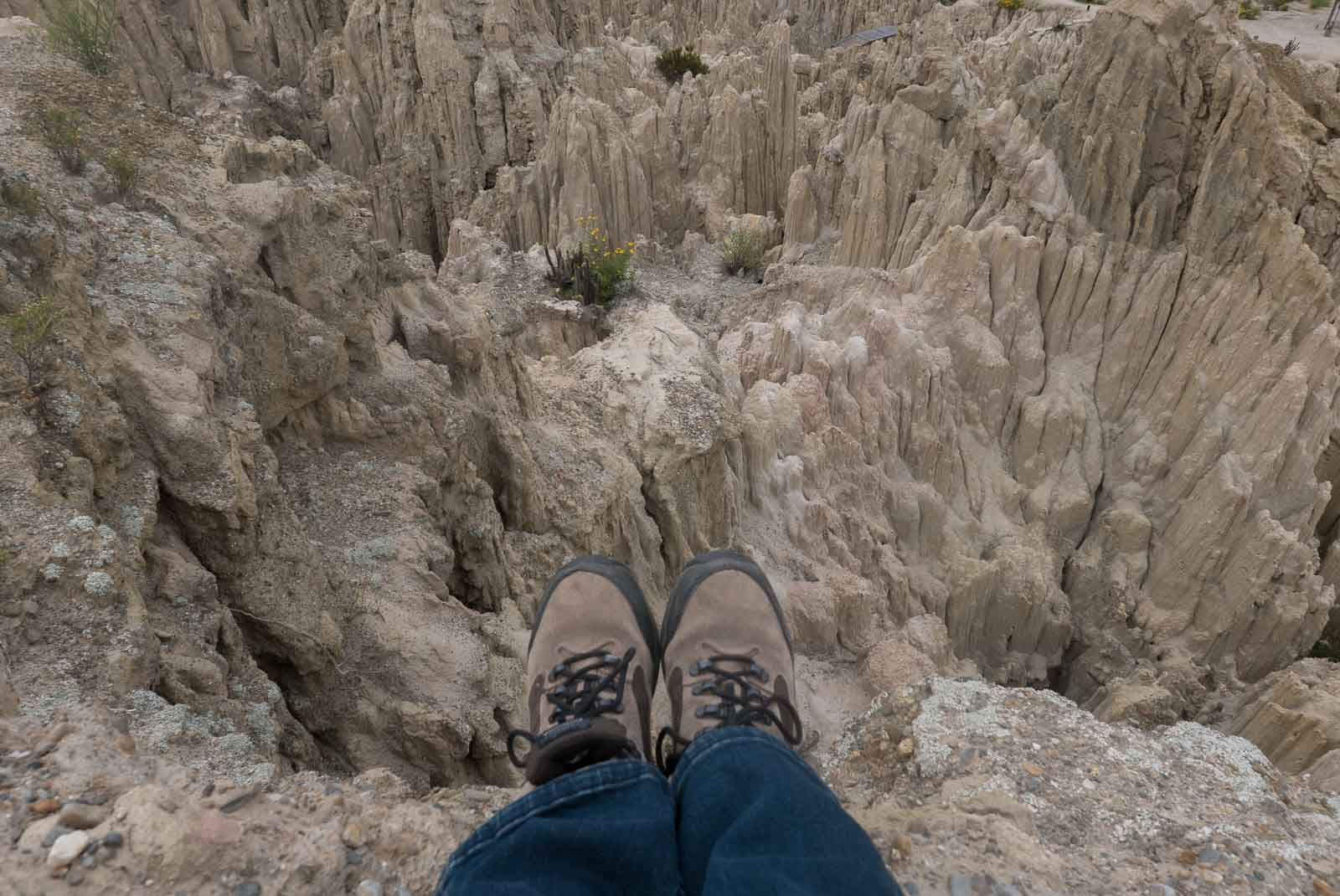 My feet! Stepping off into the abyss, or hanging over the edge of the moon.... Valle de la Luna, Valley of the Moon, in La Paz.