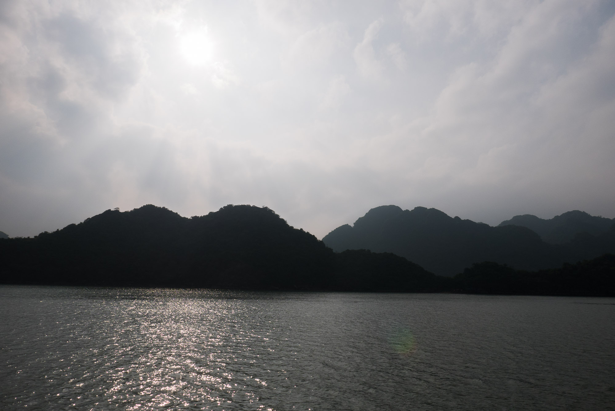 Sunset over the islands on Ha Long Bay.
