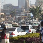 Pedestrians, bikes and cars jostle for position in the packed streets of Kampala, Uganda.