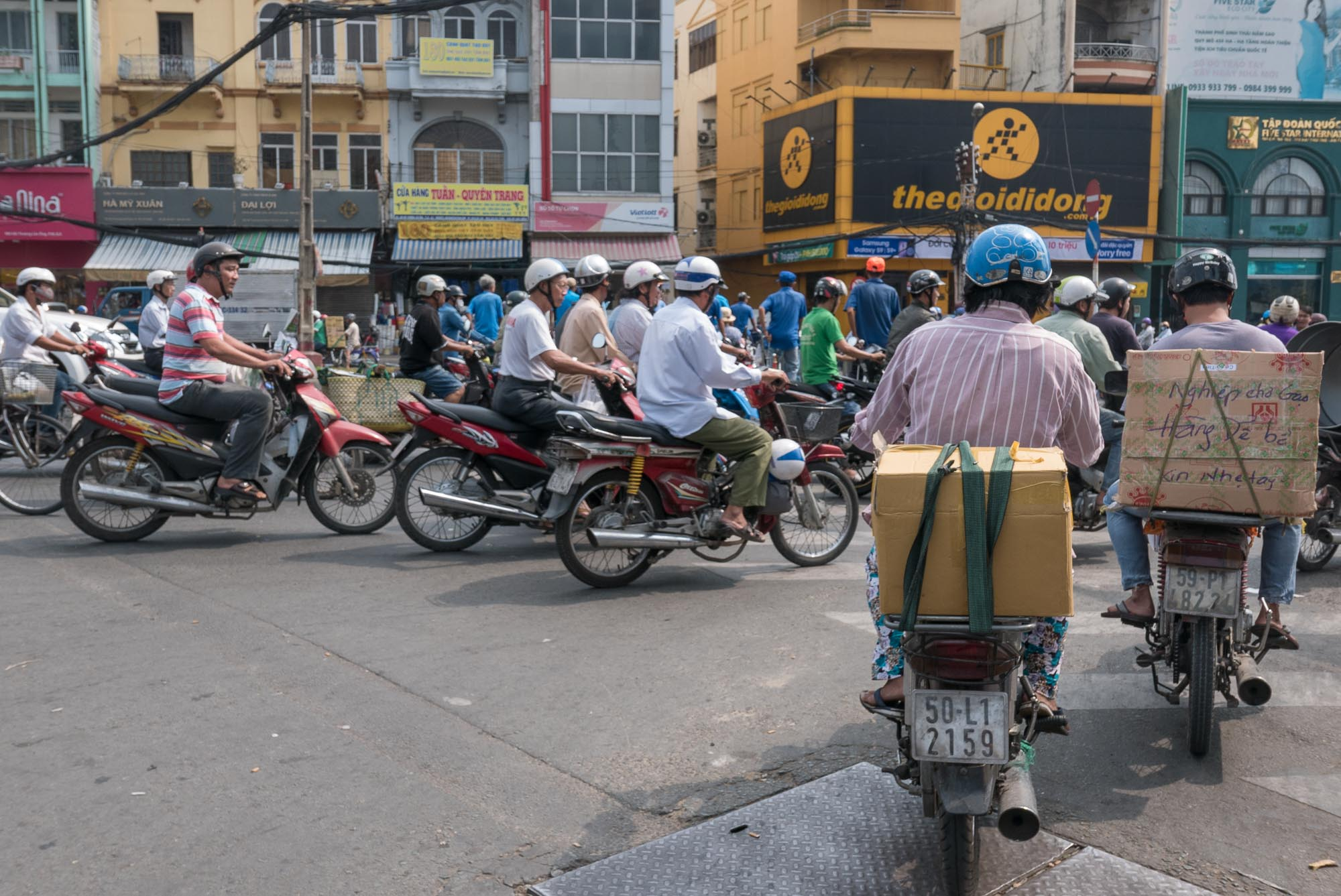 Dozens of bikes fill an intersection in Ho Chi Minh.